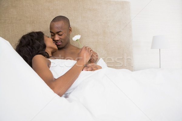 Young man offering a flower to woman Stock photo © wavebreak_media