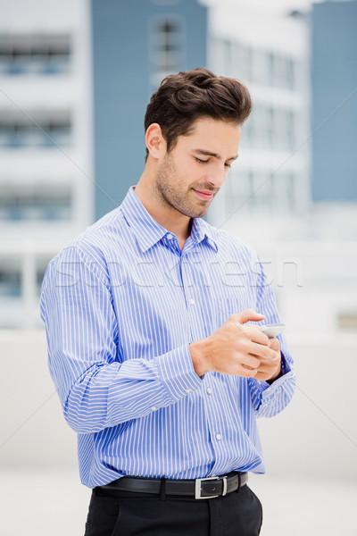 Businessman text messaging on mobile phone Stock photo © wavebreak_media