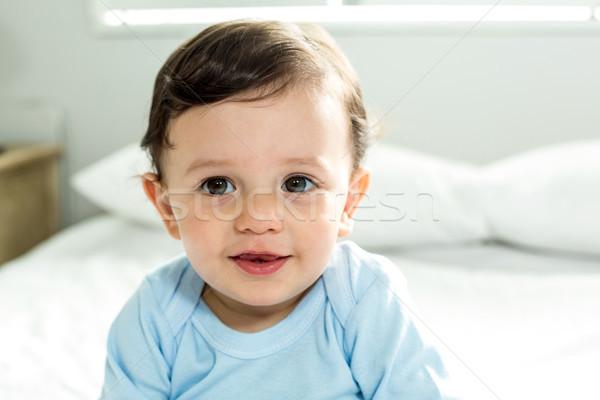 Portret cute baby jongen vergadering bed Stockfoto © wavebreak_media