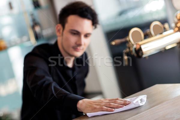 Barkeeper cleaning counter with napkin  Stock photo © wavebreak_media