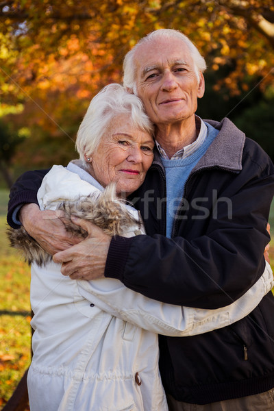 Smiling senior couple embracing at park Stock photo © wavebreak_media
