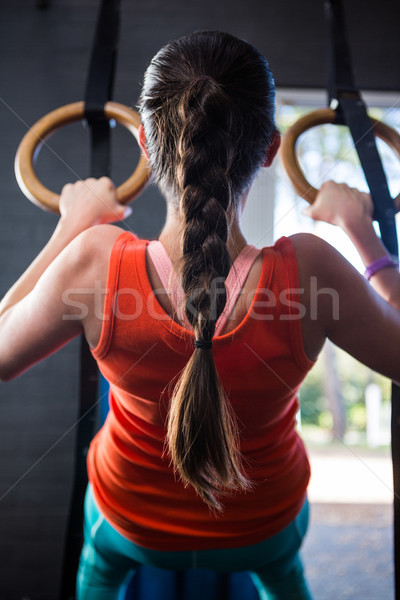 Hátsó nézet fiatal atléta tart gimnasztikai gyűrűk Stock fotó © wavebreak_media