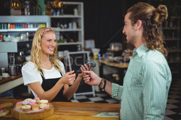 Happy customer giving credit card to waitress Stock photo © wavebreak_media