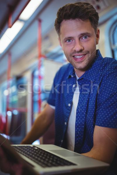 Portré jóképű férfi laptopot használ vonat utazás számítógép Stock fotó © wavebreak_media