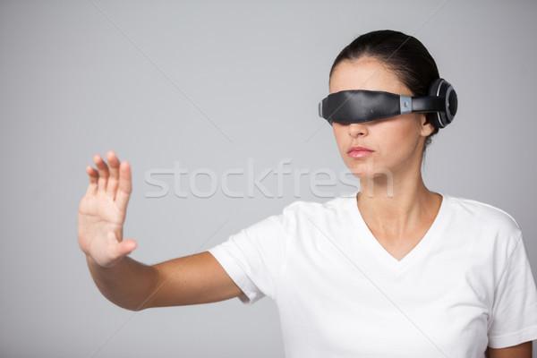 Woman using virtual video glasses Stock photo © wavebreak_media
