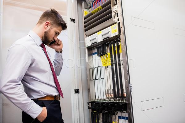 Technician talking on mobile phone in server room Stock photo © wavebreak_media