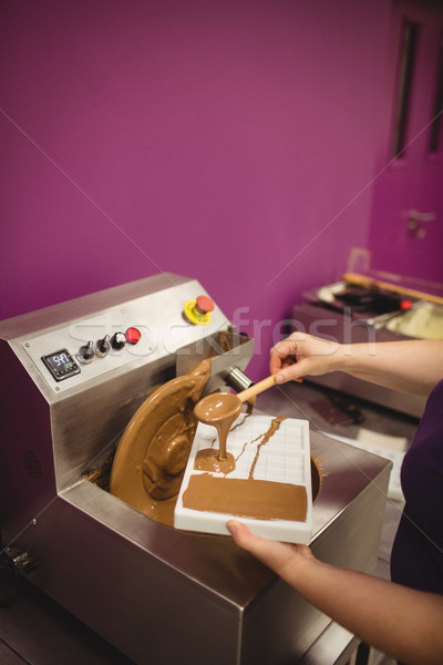 Mid section of worker filling mould with melted chocolate Stock photo © wavebreak_media