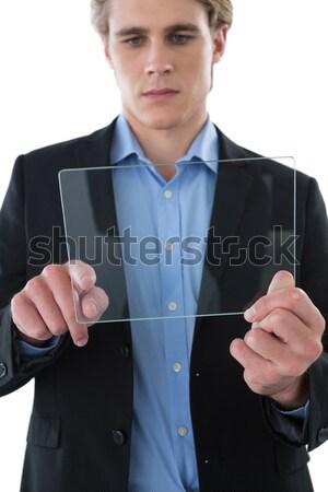 Businessman pretending to check wrist watch Stock photo © wavebreak_media