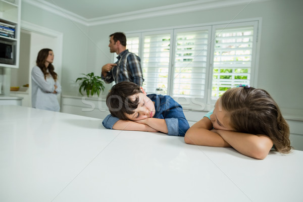 Stock photo: Sad siblings listening their parents having an argument