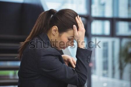 落ち込んで 女性実業家 手 頭 オフィス 女性 ストックフォト © wavebreak_media