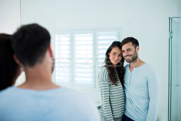 Couple looking in bathroom mirror together Stock photo © wavebreak_media