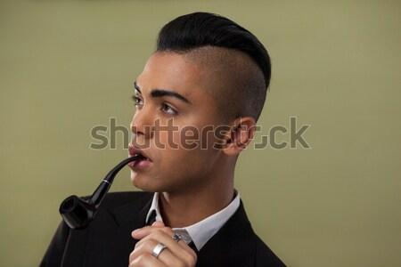 Portret kobieta dymu rury krzesło Zdjęcia stock © wavebreak_media