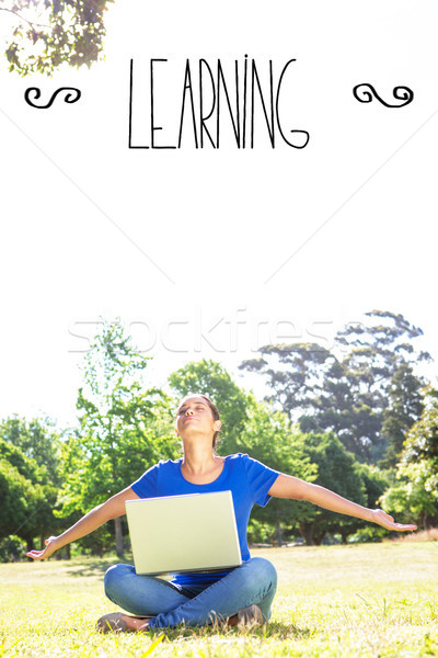 Learning against carefree woman using laptop in park Stock photo © wavebreak_media