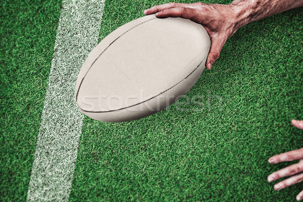 Composite image of cropped image of a man holding rugby ball Stock photo © wavebreak_media