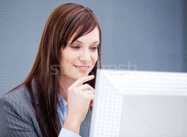 Radiant businesswoman working at a computer Stock photo © wavebreak_media