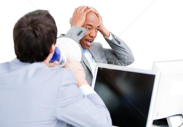 Mérges fiatal üzletember kiabál megafon iroda Stock fotó © wavebreak_media