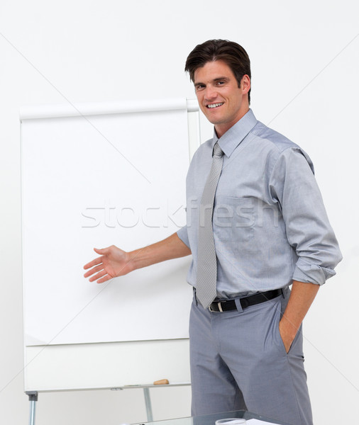 Self-assured businessman pointing at a board  Stock photo © wavebreak_media