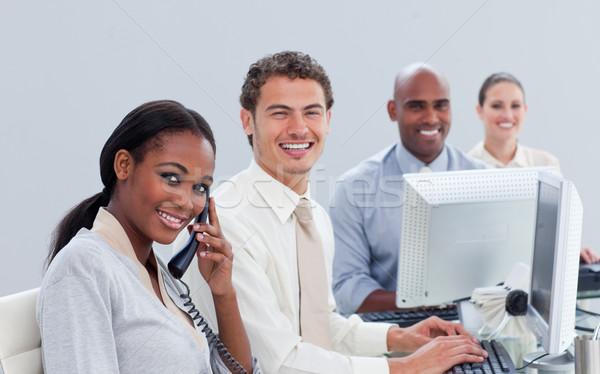 Hırslı iş ekibi çalışmak ofis telefon klavye Stok fotoğraf © wavebreak_media