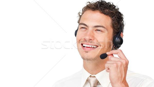 Gioioso imprenditore auricolare isolato bianco ufficio Foto d'archivio © wavebreak_media