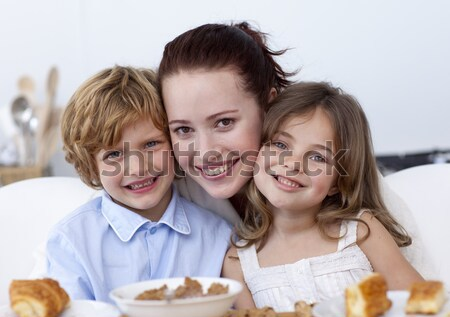 Happy family watching television and eating chips Stock photo © wavebreak_media
