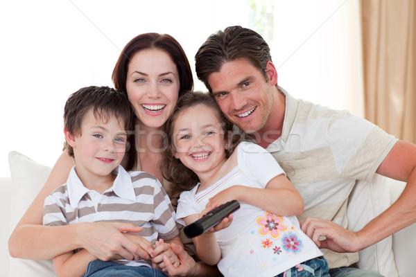 Stock fotó: Portré · boldog · család · néz · tv · kanapé · család