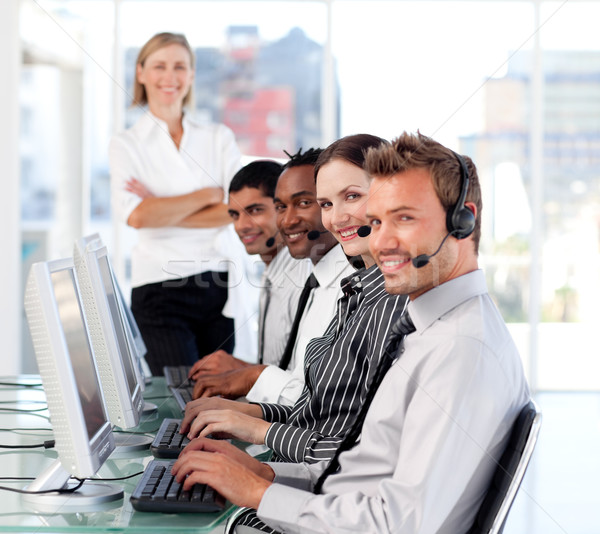 Cheerful female leader managingher team in a call center Stock photo © wavebreak_media