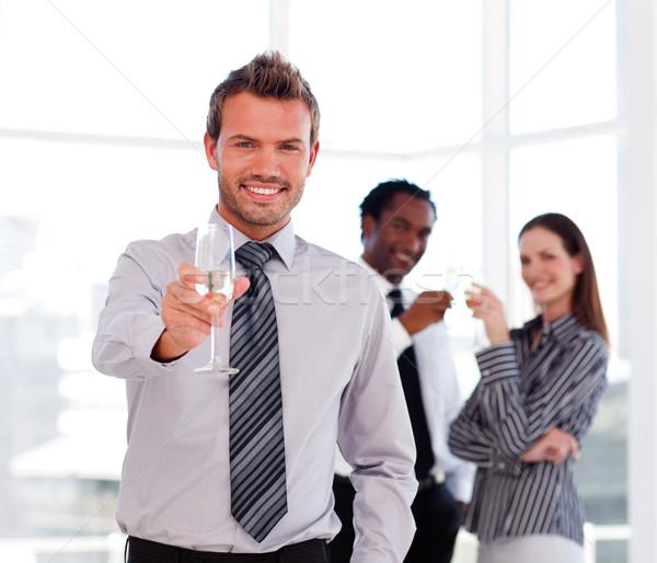 Handsome businessman celebrating a success  Stock photo © wavebreak_media