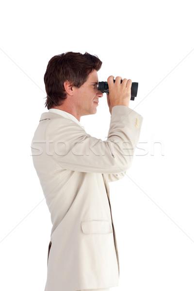 Good-looking businessman using binoculars Stock photo © wavebreak_media