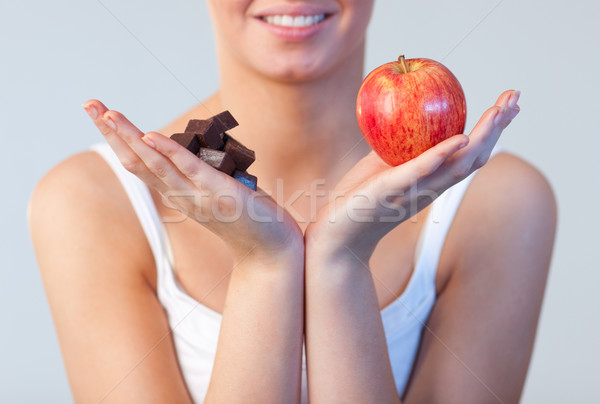 Close-up of woman showing chocolate and apple focus on chocolate and apple  Stock photo © wavebreak_media