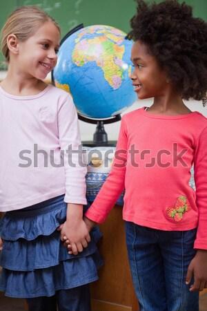 Assertive businesswoman holding terrestrial globe Stock photo © wavebreak_media