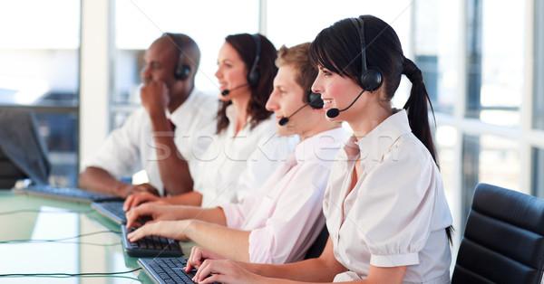 Portrait of a young multi-ethnic sale representative team at work in a office Stock photo © wavebreak_media