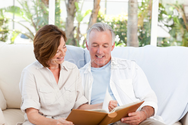 Seniors looking at their photo album at home Stock photo © wavebreak_media