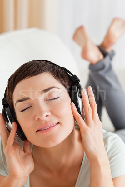 Portré bájos barna hajú zenét hallgat csukott szemmel zene Stock fotó © wavebreak_media