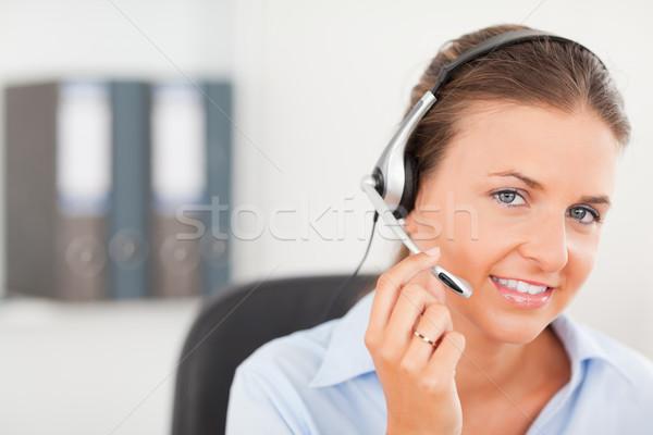 An operator is supporting a customer via headset Stock photo © wavebreak_media