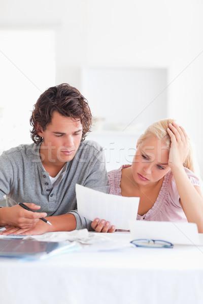 Worried Couple with Paperwork in their living room Stock photo © wavebreak_media
