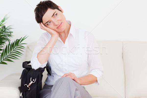 Fáradt üzletasszony táska váróterem nő virág Stock fotó © wavebreak_media