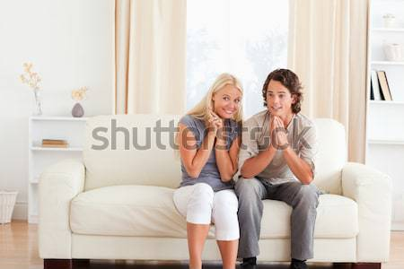 Young women lounging on a sofa in a living room Stock photo © wavebreak_media