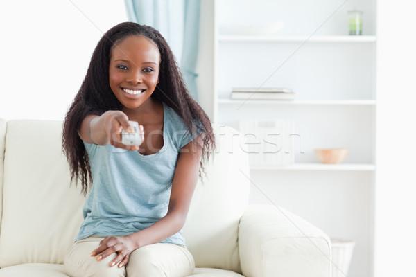 Sorridere divano telecomando tecnologia soggiorno Foto d'archivio © wavebreak_media