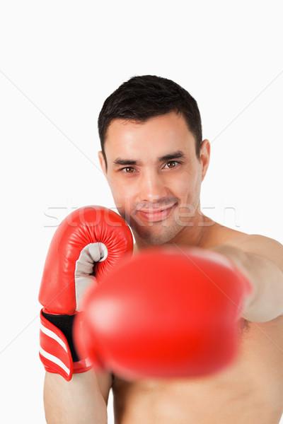 Souriant boxeur poing blanche sport fond Photo stock © wavebreak_media