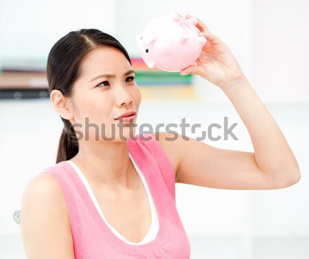 Healthy woman working out with dumbbells against a white background Stock photo © wavebreak_media