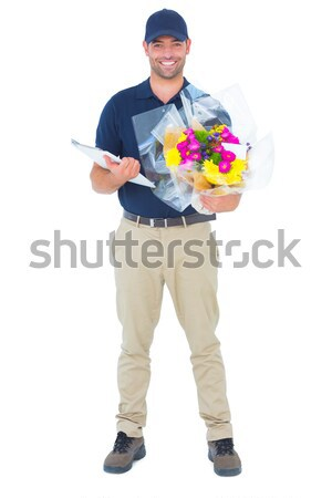 Young construction worker taking notes against a white background Stock photo © wavebreak_media