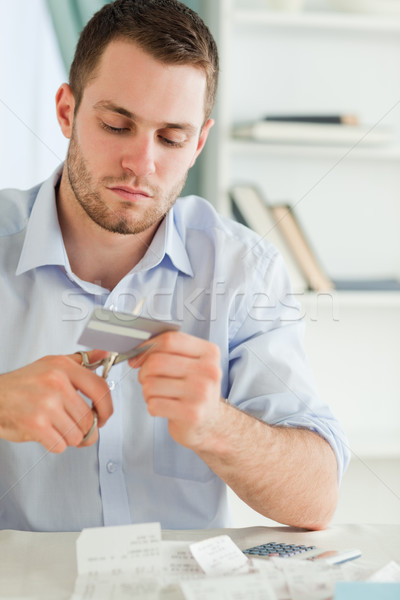 Young businessman using scissor to destroy his credit card Stock photo © wavebreak_media
