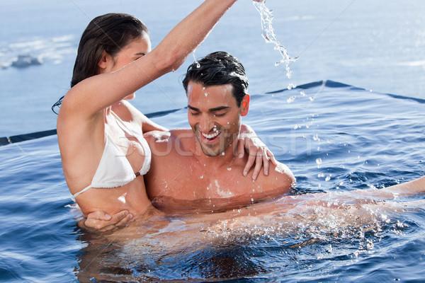 Hombre juguetón esposa piscina agua Foto stock © wavebreak_media