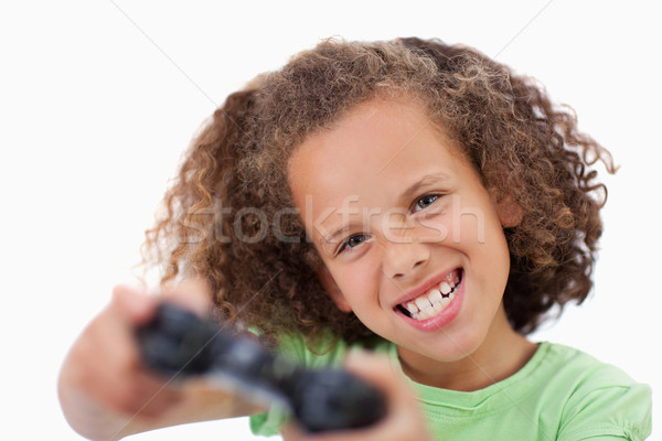 Girl playing a video game against a white background Stock photo © wavebreak_media