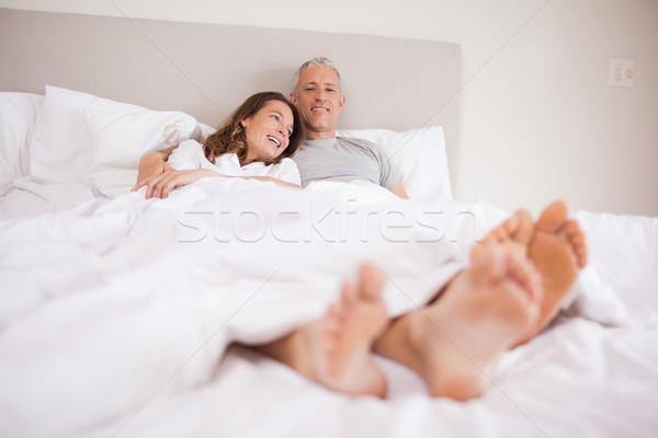 очаровательный пару кровать улыбка лице Сток-фото © wavebreak_media