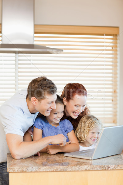 Family exploring the internet in the kitchen together Stock photo © wavebreak_media