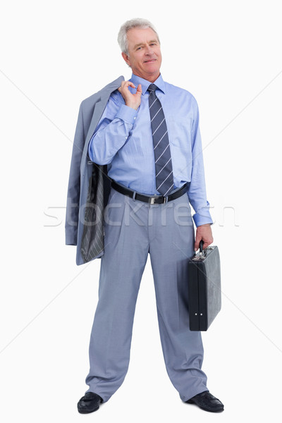 Stock photo: Mature tradesman standing with suitcase and jacket over his shoulder against a white background