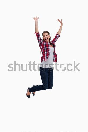 Portrait of a cheerful woman jumping against a white background Stock photo © wavebreak_media
