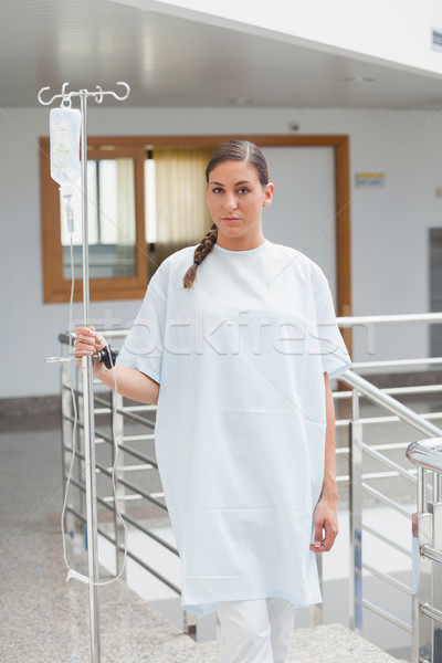 Female patient holding a drip stand in the corridor in hospital  Stock photo © wavebreak_media