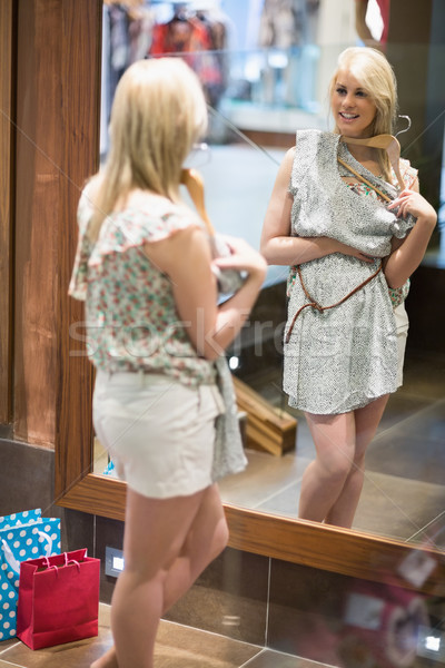 Woman smiling in a boutique while standing in front of a mirror Stock photo © wavebreak_media